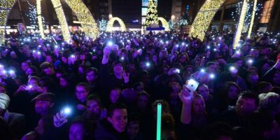 Crowd celebrating Christmas lights being switched on in Coventry